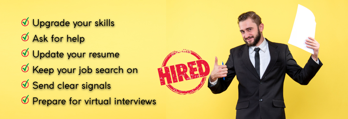A man is with a job application holding his thumb up as he is now hired